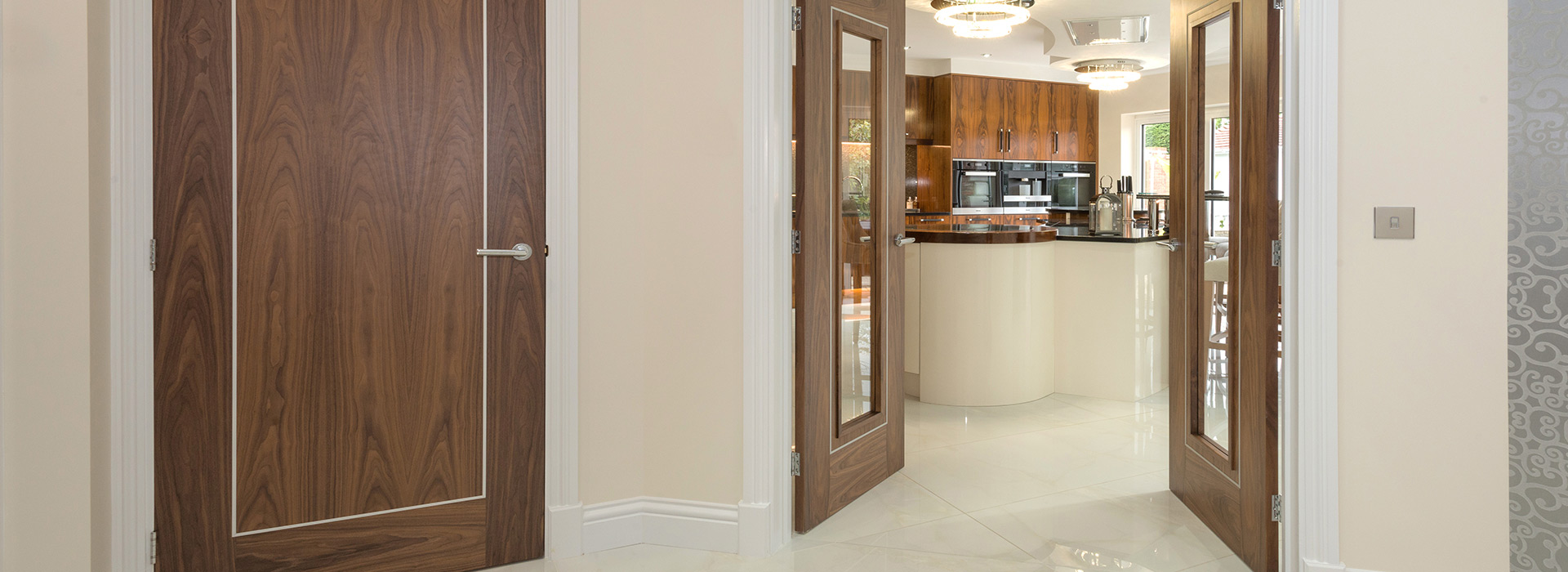 Modern kitchen with walnut double doors