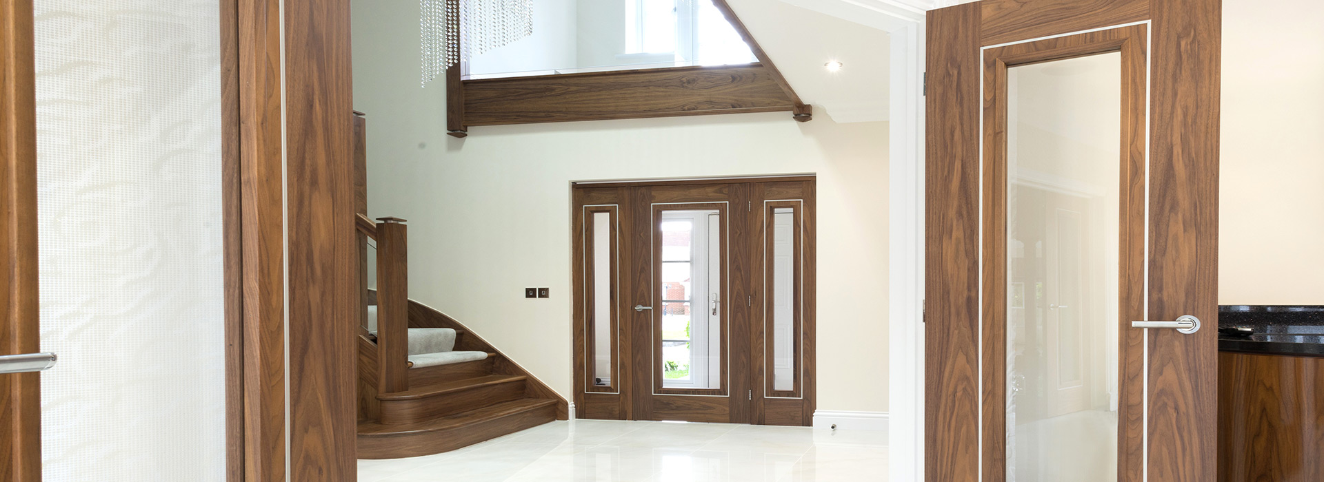 Tiled hallway with Walnut stairs