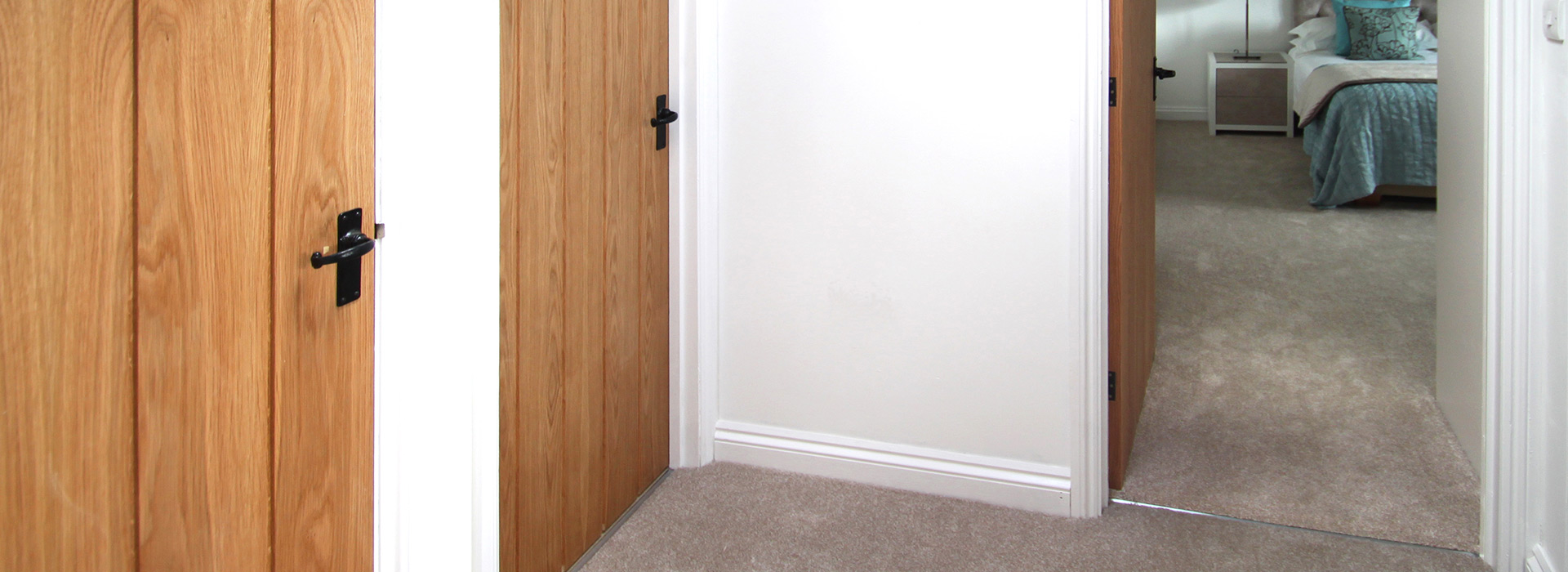 Countryman grooved doors for hallway