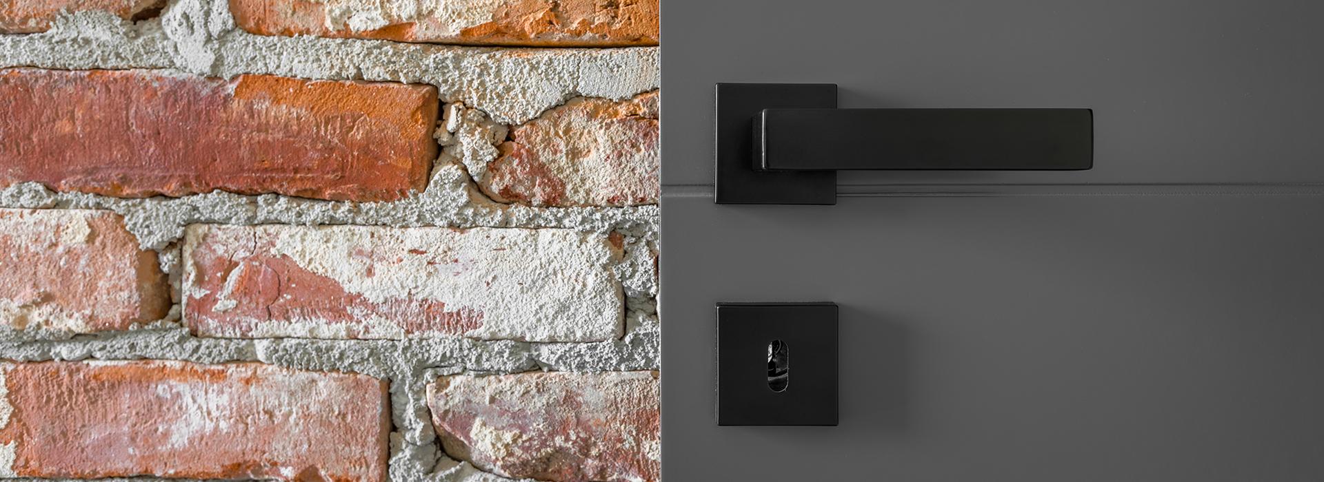 Grey door with black handle