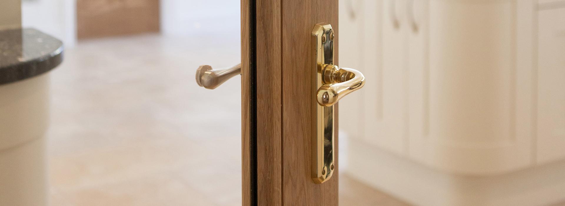 Glazed door with brass handle