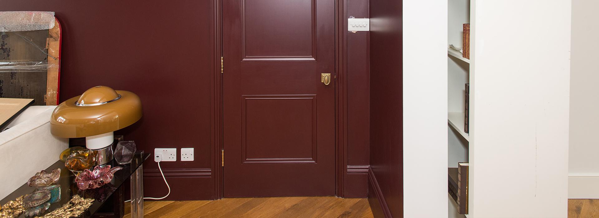 Burgundy door with brass handle