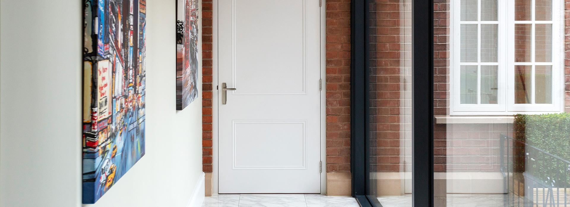 Traditional door in modern hallway