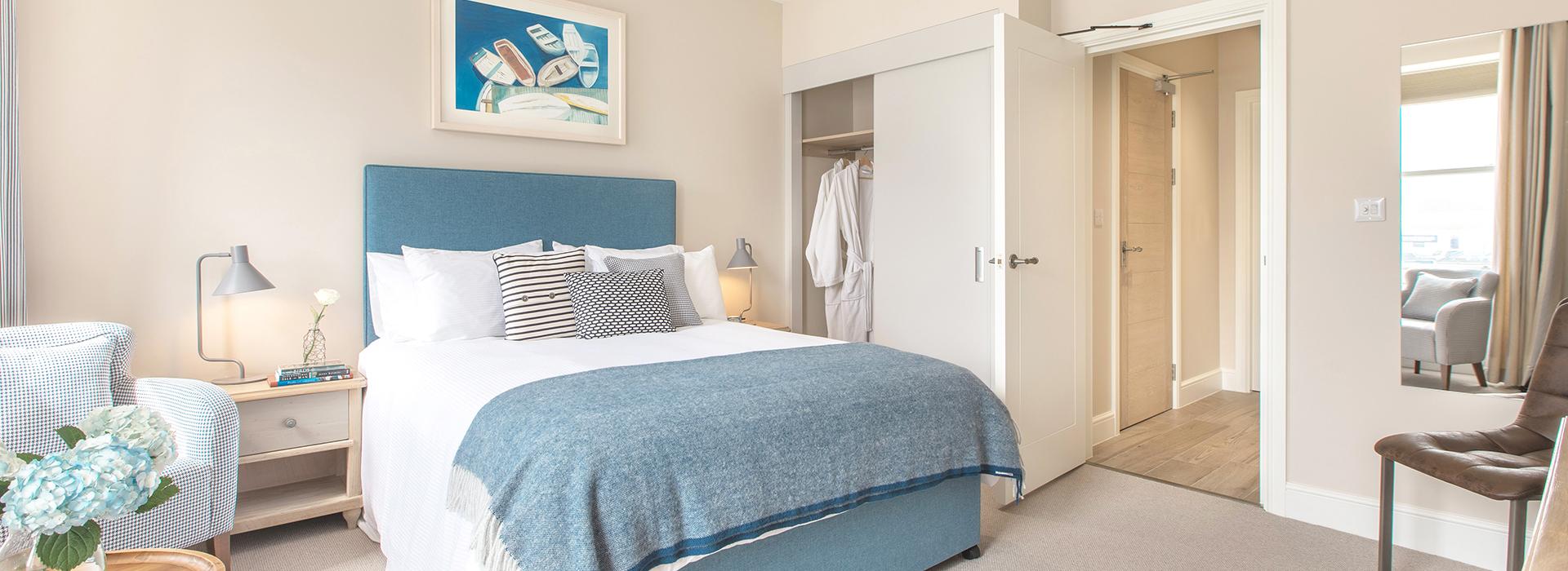 Crisp white bedroom with white door