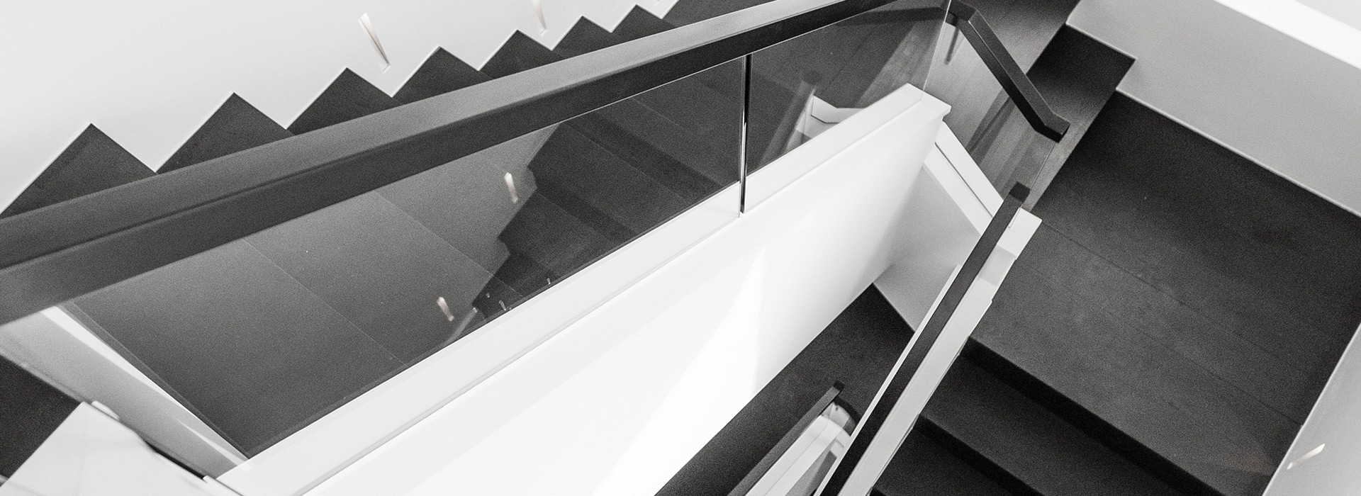 Glass balustrade staircase in slate black